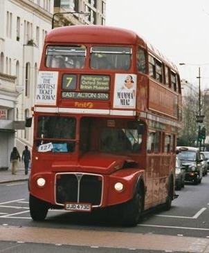 This London double decker bus is enclosed on top--but also has no driver.  ;-)